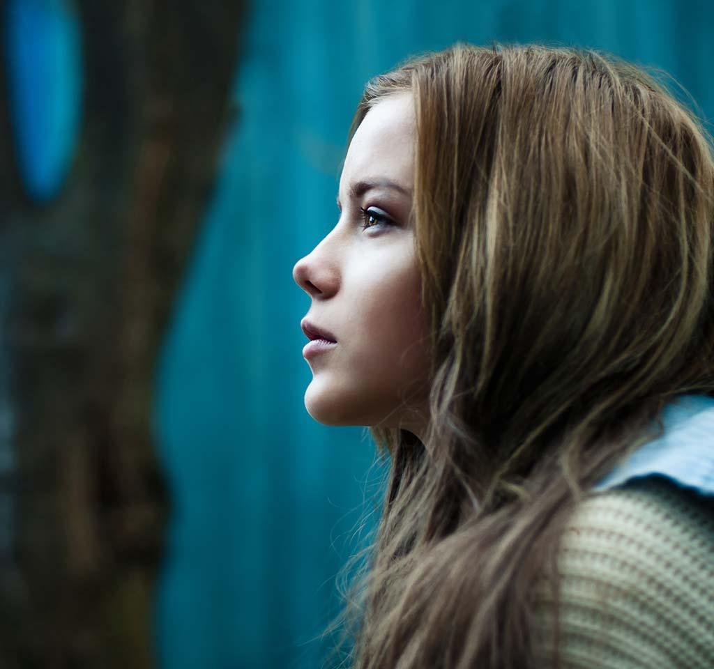 Young girl reflecting.